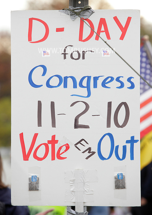 Town of Wallkill, New York - Tea bags are taped to a political poster on a road sign on the side of Route 211 during a rally organized by the Orange/Sullivan County 912 Tea Party on Oct. 23, 2010.
