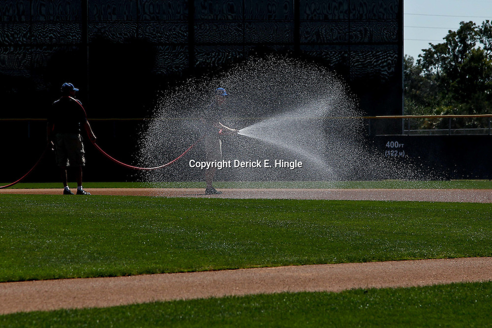 March 6, 2011; Dunedin, FL, USA; The grounds crew sprays the infield before a spring training game between the Toronto Blue Jays and the Philadelphia Phillies at Florida Auto Exchange Stadium. Mandatory Credit: Derick E. Hingle-US PRESSWIRE