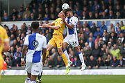Millwall's Shaun Hutchinson(4) and Bristol Rovers Jake Clarke-Salter(36) challenge for the ball during the EFL Sky Bet League 1 match between Bristol Rovers and Millwall at the Memorial Stadium, Bristol, England on 30 April 2017. Photo by Shane Healey.