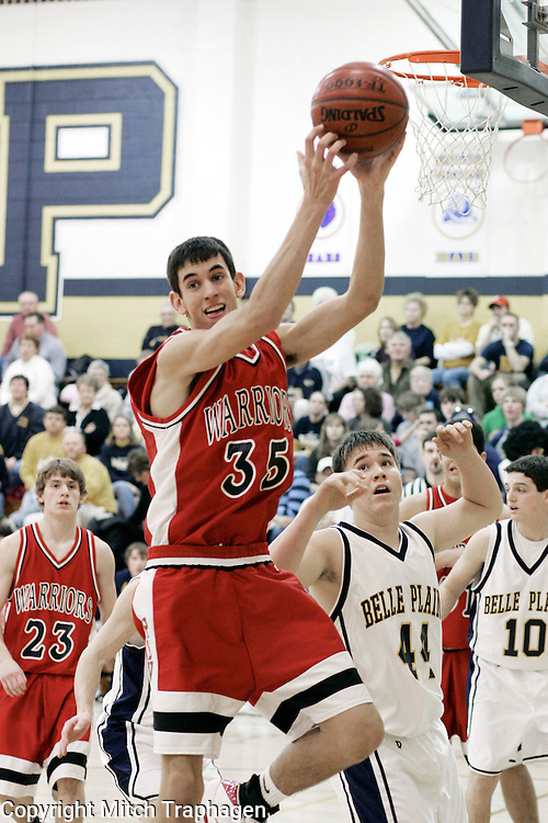 Scott Blomme of HLV High School in Victor, Iowa, defends the goal with style HLV Basketball