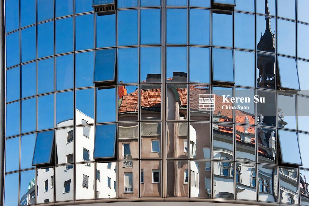 Reflection of historic building on glass window, Maribor, Slovenia