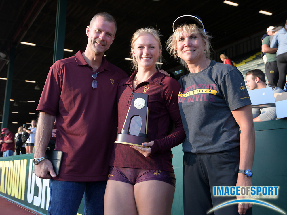 Jun 7, 2018; Eugene, OR, USA; Maggie Ewen of Arizona State (center) poses with father Bruce Ewen (left) and Kristi Ewen after winning the women's shot put during the NCAA Track and Field championships at Hayward Field.