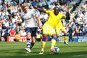 Preston Striker Eoin Doyle challenged by Leeds United defender, Souleman Bamba (3) during the Sky Bet Championship match between Preston North End and Leeds United at Deepdale, Preston, England on 7 May 2016. Photo by Pete Burns.