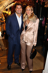 TANIA BRYER and her husband TIM MOUFFARIGE at Polo Ralph Lauren's Pink Pony Party to launch it's Pink Pony Collection in aid of Cancer Research UK, held at their Fulham Road Store, London on 13th October 2004.<br />