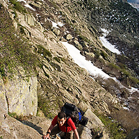 "The GR20 doesn't require special rock-climbing skills but you need a good fitness level if you want to achieve the whole trail with an overloaded backpack on your shoulders. On the bottom right corner you can see the typical red and white waymark used on French long-distance paths (Grande Randonée). Photo taken on the trek From ""Refuge de Prati"" to Cozzano."