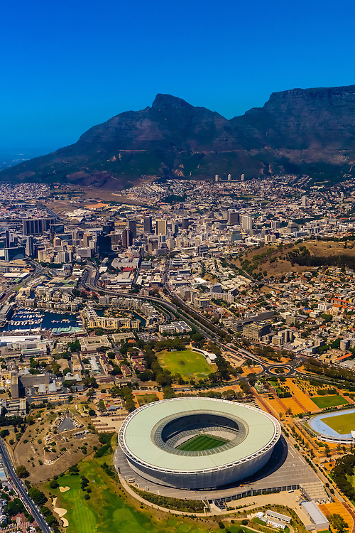 Aerial View, Cape Town Stadium and Central Business District with Table Mountain behind, Cape Town, South Africa.