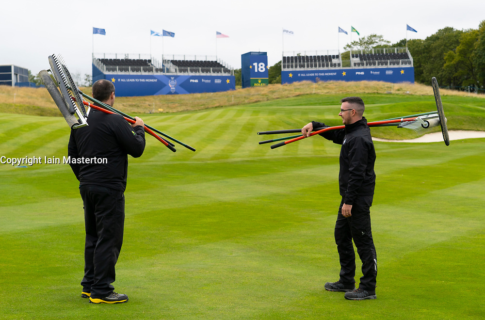 Auchterarder, Scotland, UK. 8 September 2019.  Final preparations underway at the Centenary Course at Gleneagles for the 2019 Solheim Cup between women golfers from Europe and the USA. The event runs from 9-15 September. Pictured; Greenkeepers stop to admire their work on the 18th fairway at the end of the day. Iain Masterton/Alamy Live News