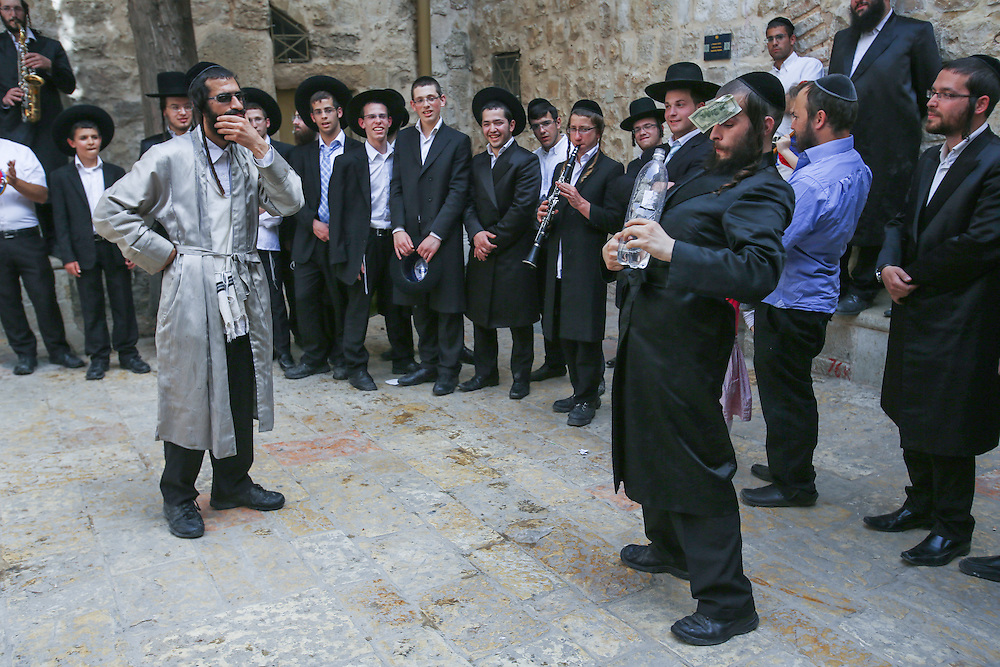 Ultra orthodox Jews play klezmer music and dance as they walk past the Yemin Moshe neighborhood into King David's Tomb in jerusalem's Old City, during the holiday of Passover. Mrach 31, 2013. Photo By Oren Nahshon
