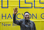 "UNITED KINGDOM, London: 22 September 2015 Legendary footballer Pele greets fans outside of the Halcyon Gallery, New Bond Street, as he launches the ""Art, Life, Football"" exhibition - in celebration of Pele's 75th birthday and a lifetime of sporting and humanitarian achievements. The exhibition opens on October 18th and includes photography, paintings and sculptures by the likes of Andy Warhol and Ronnie Wood. <br /> Credit: Story Picture Agency"