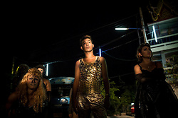 At a village festival, Ayudhaya. Thailand's Transgenders, &quot;Katheoys&quot; live in a kind of parallel universe within Thai society.<br /> <br /> Katheoys are biological men who have been born with distinctifly female hearts and minds. Some choose to have their anatomy 'corrected' whilst others are content to dress in womens clothing or simply give free reign to their effeminate mannerism.