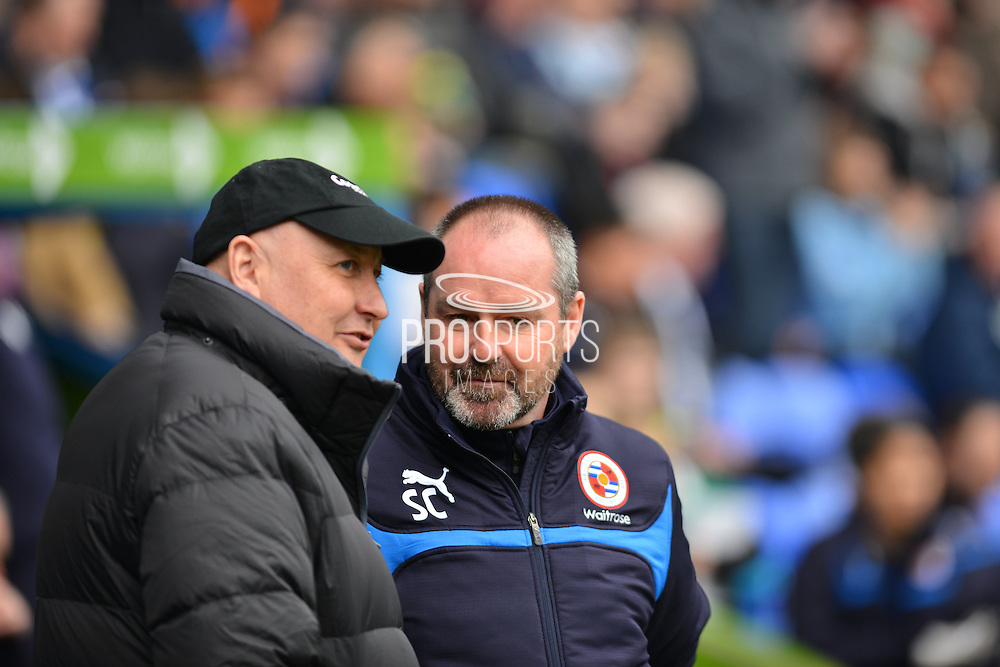 Reading's Manager Steve Clarke and Cardiff City's Manager Russell Slade during the Sky Bet Championship match between Reading and Cardiff City at the Madejski Stadium, Reading, England on 4 April 2015. Photo by Mark Davies.