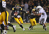 October 2 2010: Iowa Hawkeyes quarterback Ricky Stanzi (12) scrambles with the ball during the first half of the NCAA football game between the Penn State Nittany Lions and the Iowa Hawkeyes at Kinnick Stadium in Iowa City, Iowa on Saturday October 2, 2010. Iowa defeated Penn State 24-3.