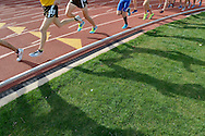 Athletes compete in a race during the Mountain West Conference Men's and Women's Outdoor Track & Field Championship held at the Madrid Sports Complex on the University of Wyoming campus in Laramie, Wyoming on May 16, 2014.