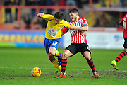 Accrington Stanley's Shay McCartan and Exeter City's Jordan Moore-Taylor during the Sky Bet League 2 match between Exeter City and Accrington Stanley at St James' Park, Exeter, England on 23 January 2016. Photo by Graham Hunt.