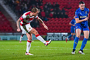Doncaster Rovers midfielder James Coppinger (26) in action during the The FA Cup match between Doncaster Rovers and AFC Wimbledon at the Keepmoat Stadium, Doncaster, England on 19 November 2019.