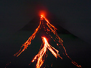 01 FEBRUARY 2018 - LEGAZPI, ALBAY, PHILIPPINES: Lava flow down the Mayon volcano as seen from the Legazpi Airport. The Mayon volcano started erupting in the middle of January. The airspace around the volcano has been closed off and on for more than week. The airport is about 13 kilometers from the volcano and the ash clouds from Mayon pose a threat to aircraft engines. More than 80,000 people have been evacuated from their homes around the volcano.     PHOTO BY JACK KURTZ
