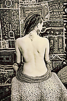 Unique woman shown from the back in a modest nude.<br /> :::<br /> &quot;The body is a sacred garment.&quot;<br /> -Martha Graham