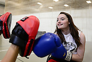 Riley Ljungdahl, 12, of Longmont, spars with Clinical Exercise Specialist Emma Dawson during physical therapy, Tuesday, April 30, 2013, at the Peak Center at Craig Hospital.<br /> (Matthew Jonas/Times-Call)