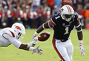 AUBURN, AL - AUGUST 30:  Linebacker TQ Coleman #7 of the Arkansas Razorbacks causes D'haquille Williams #1 of the Auburn Tigers to fumble out of bounds during the game at Jordan Hare Stadium on August 30, 2014 in Auburn, Alabama.  (Photo by Mike Zarrilli/Getty Images)