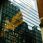 reflection of a taxi sign in a building