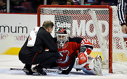 Mar 30, 2007; East Rutherford, NJ, USA; New Jersey Devils goalie Martin Brodeur (30) is checked out by the trainer after making a save during the first period at Continental Airlines Arena in East Rutherford, NJ.