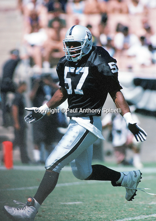 Los Angeles Raiders linebacker Joe Kelly (57) chases the action during the NFL football game against the Minnesota Vikings on Sept. 5, 1993 in Los Angeles. The Raiders won the game 24-7. (©Paul Anthony Spinelli)