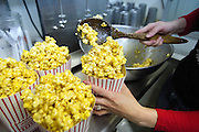 PRICE CHAMBERS / NEWS&amp;GUIDE<br /> Miriam Penfold makes caramel popcorn at The Spud, a popular treat well-paired with a night out at the movies.