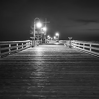 San Clemente pier at night black and white picture. San Clemente is a popular coastal beach city in Orange County California in the United States of America. Copyright ⓒ 2017 Paul Velgos with All Rights Reserved.