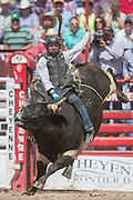 Bull rider Clayton Foltyn of Winnie, Texas emerges from the chute on Helter Skelter at the Cheyenne Frontier Days rodeo at Frontier Park Arena July 24, 2015 in Cheyenne, Wyoming. Frontier Days celebrates the cowboy traditions of the west with a rodeo, parade and fair.