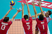 (R) Michal Kubiak from Poland in action during the 2013 CEV VELUX Volleyball European Championship match between Poland v Slovakia at Ergo Arena in Gdansk on September 22, 2013.<br /> <br /> Poland, Gdansk, September 22, 2013<br /> <br /> Picture also available in RAW (NEF) or TIFF format on special request.<br /> <br /> For editorial use only. Any commercial or promotional use requires permission.<br /> <br /> Mandatory credit:<br /> Photo by &copy; Adam Nurkiewicz / Mediasport
