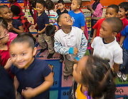 Students react to the news they will receive free books during a Touchdown Houston Read On literacy program at Ross Elementary School, December 2, 2016.