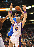 Feb. 4, 2011; Phoenix, AZ, USA; Oklahoma City Thunder guard Russell Westbrook (0) puts up a shot against the Phoenix Suns forward Marcin Gortat (4) at the US Airways Center. Mandatory Credit: Jennifer Stewart-US PRESSWIRE