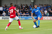AFC Wimbledon defender Rod McDonald (4) dribbling during the Pre-Season Friendly match between AFC Wimbledon and Bristol City at the Cherry Red Records Stadium, Kingston, England on 9 July 2019.