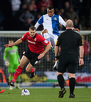 Football - 2012 / 2013 Championship - Blackburn Rovers vs. Cardiff City<br /> Joshua King of Blackburn Rovers goes in high on Cardiff's Ben Turner in full of referee Simon Hooper at Ewood Park