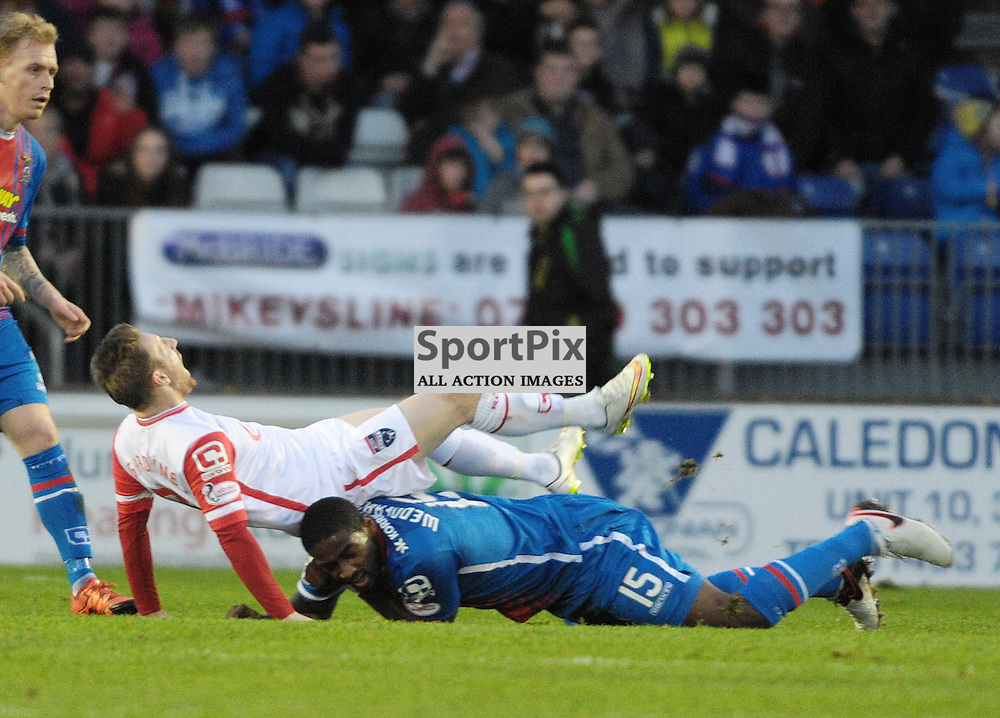 Nat Wedderburn (ICT, Blue &amp; Red) was booked for this tackle on Michael Gardyne (Ross County, white)<br /> <br /> Inverness Caledonian Thistle v Ross County, Ladbroke's Premiership, Saturday 2nd January 2016<br /> <br /> (c) Alex Todd | SportPix.org.uk