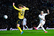 Leeds United defender Gjanni Alioski (10) takes a shot during the EFL Sky Bet Championship match between Leeds United and Millwall at Elland Road, Leeds, England on 28 January 2020.