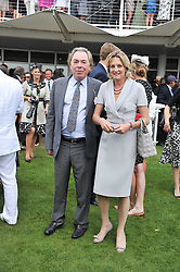 LORD & LADY LLOYD-WEBBER at the 3rd day of the 2011 Glorious Goodwood Racing Festival - Ladies Day at Goodwood Racecourse, West Sussex on 28th July 2011.