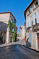 Quiet street scene in the historic city of Arles, France.
