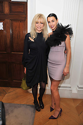 Left to right, JO WOOD and ASSIA WEBSTER at a party to launch the Georgina Chapman collection for Garrard held at Garrard, Albermarle Street, London on 4th November 2009.