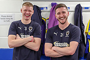 AFC Wimbledon goalkeeper Joe McDonnell (24) and AFC Wimbledon goalkeeper Aaron Ramsdale (35) in the changing room prior to kick off during the EFL Sky Bet League 1 match between AFC Wimbledon and Accrington Stanley at the Cherry Red Records Stadium, Kingston, England on 6 April 2019.