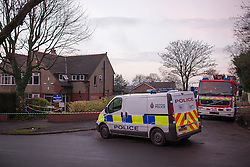 © Licensed to London News Pictures . 10/12/2013 . Bolton , UK . Police van and fire engine outside the house . The scene outside 123 Albert Road West in Bolton today (10th December 2013) where three people died following a fire , yesterday morning (9th December 2013) . Police believe the fire was started deliberatively by architect Hassan Rafie , killing himself and his wife Mahnaz . Another woman staying in the house at the time , believed to be Mrs Rafie's mother , later died of injuries sustained in the fire , in hospital . Photo credit : Joel Goodman/LNP