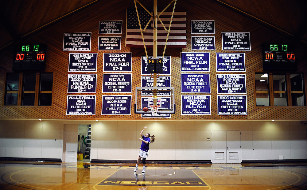 Amherst College's Lily Johnson warms up on the court before a game against Hamilton College, Friday, Jan. 9, 2015, in Amherst, Mass. Amherst has broken UConn's women's NCAA record with 104 consecutive home victories and is closing in on the Kentucky men's record of 120-plus wins set decades ago. (Jessica Hill for the New York Times)