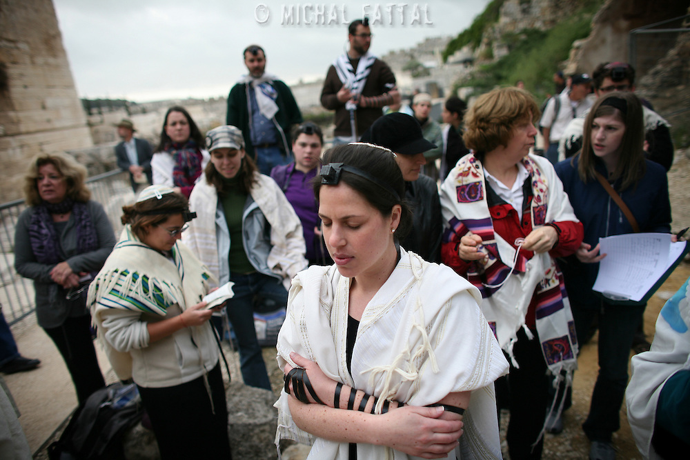 Jewish women of the Women of the Wall organization pray as they wear a phylacteries near the Western Wall Judiasm's holiest site in Jerusalem's Old City. Women of the Wall is a group of mostly religiously observant women who believe that women should be allowed to pray as a group at the Western Wall read from a Torah scroll and wear prayer shawls and phylacteries that in orthodox Judaism are used only by men.