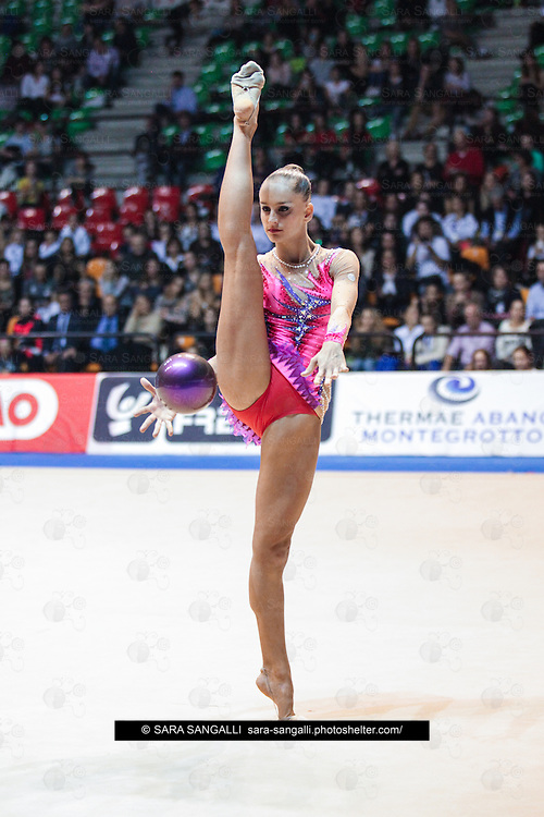 DESIO, ITALY - OCTOBER 31 2015: Veronica Bertolini of San Giorgio Desio performs with ball at the italian national rhythmic gymnastic championship. Her score in the apparatus is 17,000. Her team's score is 98,400 and ended up in second position.