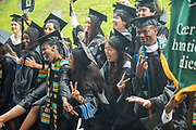 Center for International Studies students pose for a photo at graduate commecement. Photo by Ben Siegel