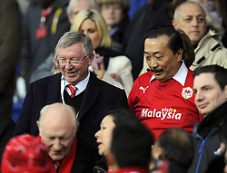 Sir Alex Ferguson is shown to his seat by Cardiff City owner, Vincent Tan  - Photo mandatory by-line: Joseph Meredith/JMP - Tel: Mobile: 07966 386802 - 24/11/2013 - SPORT - FOOTBALL - Cardiff City Stadium - Cardiff City v Manchester United - Barclays Premier League.