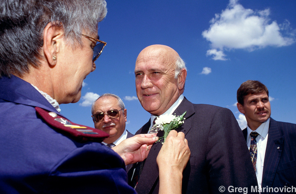 A nursing sister pins a flower in President FW de Klerk's lapel when he  visits Baragwaneth hospital, Soweto ahead of the 1994 election in South Africa.