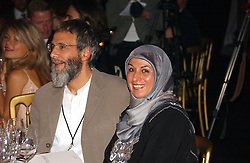 YUSUF ISLAM former known as Cat Stevens with wife at the Fortune Forum Dinner held at Old Billingsgate, 1 Old Billingsgate Walk, 16 Lower Thames Street, London EC3R 6DX<br />
