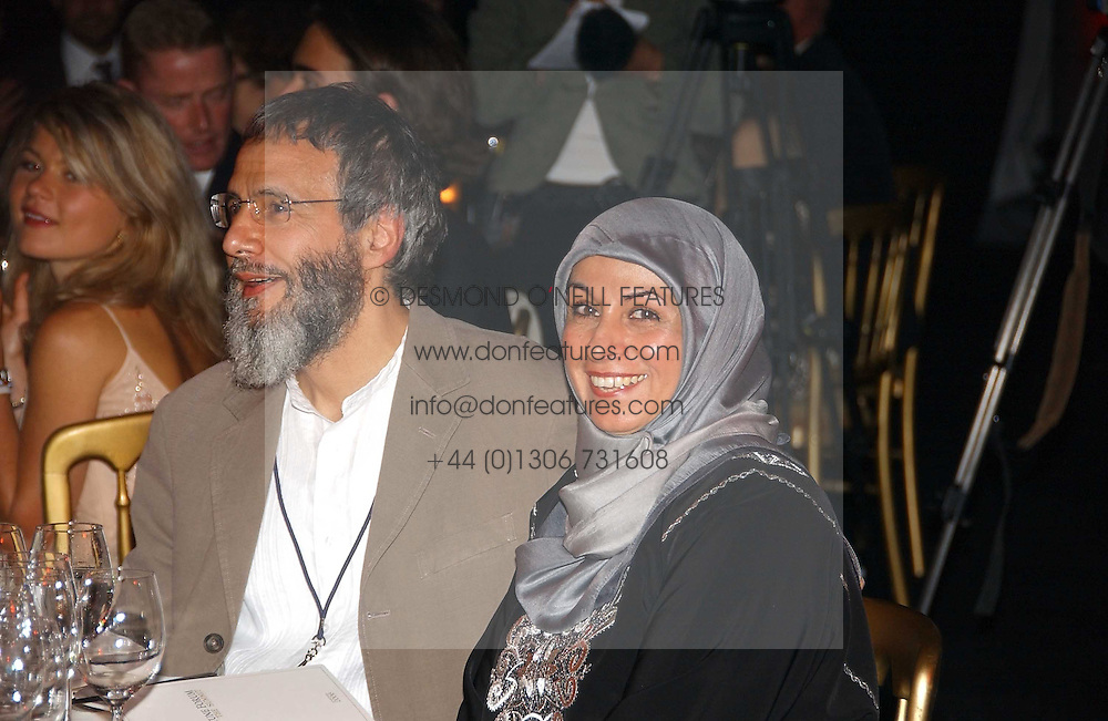 YUSUF ISLAM former known as Cat Stevens with wife at the Fortune Forum Dinner held at Old Billingsgate, 1 Old Billingsgate Walk, 16 Lower Thames Street, London EC3R 6DX<br /><br />NON EXCLUSIVE - WORLD RIGHTS