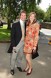 The HON.CAMILLA ASTOR and DOMINIC TRUSTED at the wedding of Hugh van Cutsem to Rose Astor in Burford, Oxfordshire on 4th June 2005.<br />